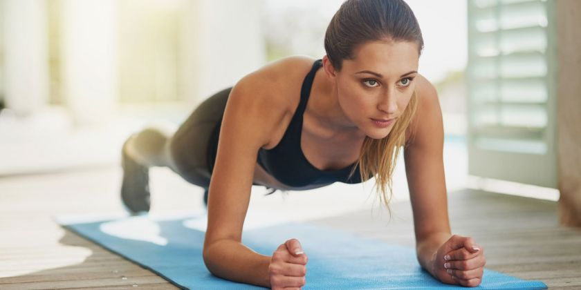 landscape-1500369952-woman-doing-plank-at-home